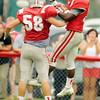 Coron Broomfield celebrates a touchdown with teammate David York (58)