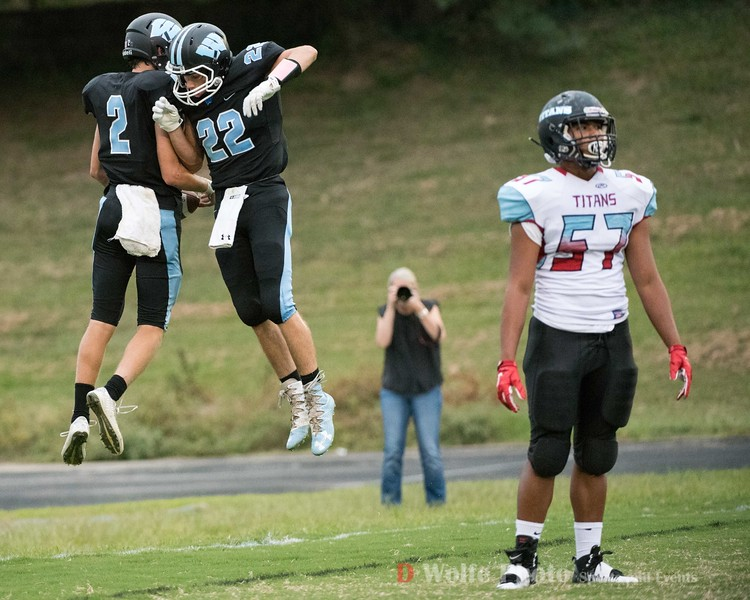 Whitman junior wide receiver Owen Roegge and senior wide receiver Carter Hughes celebrate Roegge's touchdown as an Einstein player gathers his thoughts.