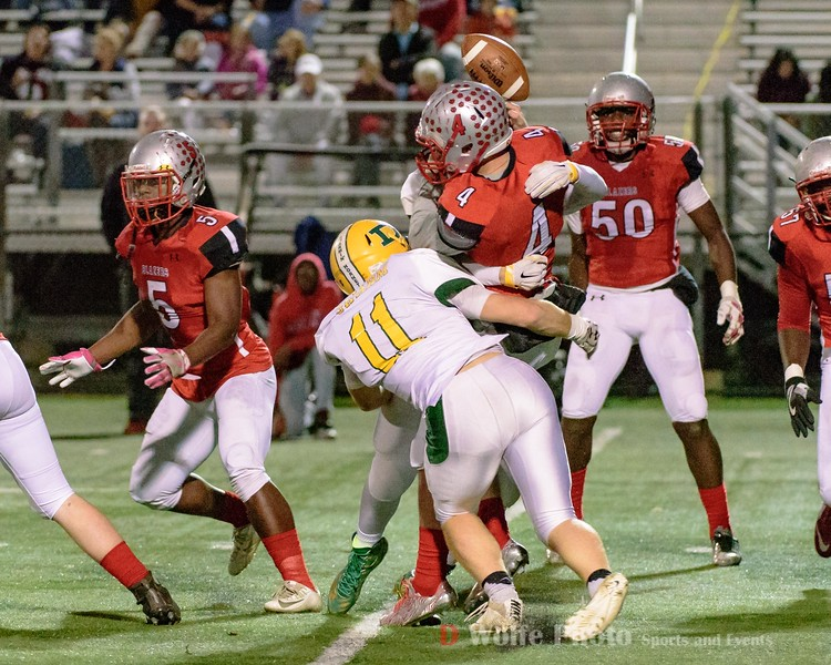 Damascus tight end Elijah Baisden and Gabe Mendez iii sandwich Blair quarterback Desmond Colby causing a fumble recovered by Blair.