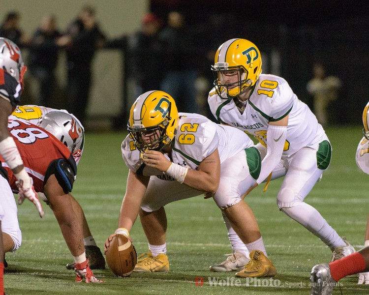 Damascus center Max Hoffman waits for the signal to hike the ball to quarterback Wade Rippeon.