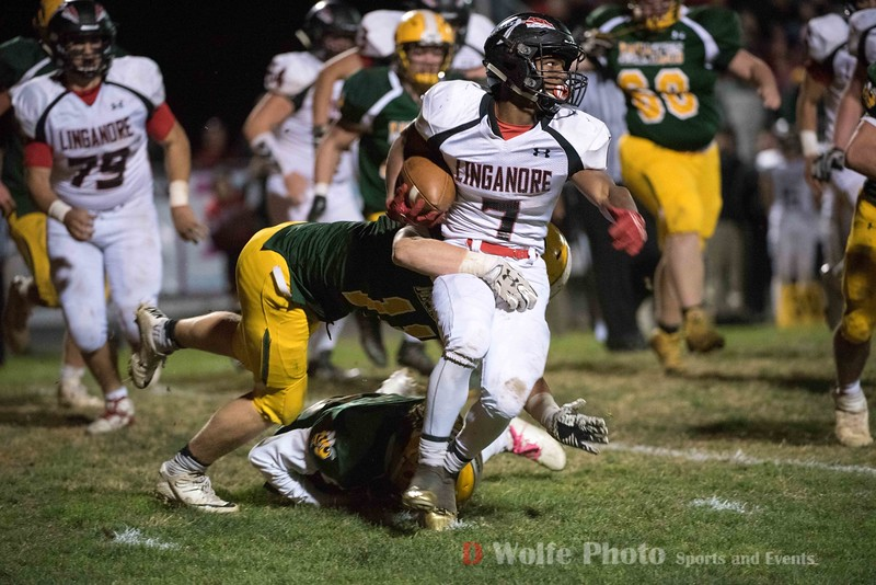 Zamarre Snowden a junior and running back from Linganore High School get trangled up behind the line  and stopped by Damascus' tight end Elijah Baisden.  Damasucs won 21 to 7 over Linganore who could not move the ball forward enough to threaten a win over Damascus.
