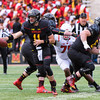 Senior Terp quarterback  Perry Hills fakes a hand off then flashes right to pick up yardage.
