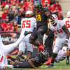 Terp defensive lineman Cavon Walker goes to the air to prevent a roughing the passer penalty as the Scarlet Kights QB Giovanni Rescigno gets sacked.
