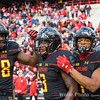 Tyrell Pigrome gets congratulated by D.J. Moore and Derrick Hayward after Pigrome scored a touchdown.