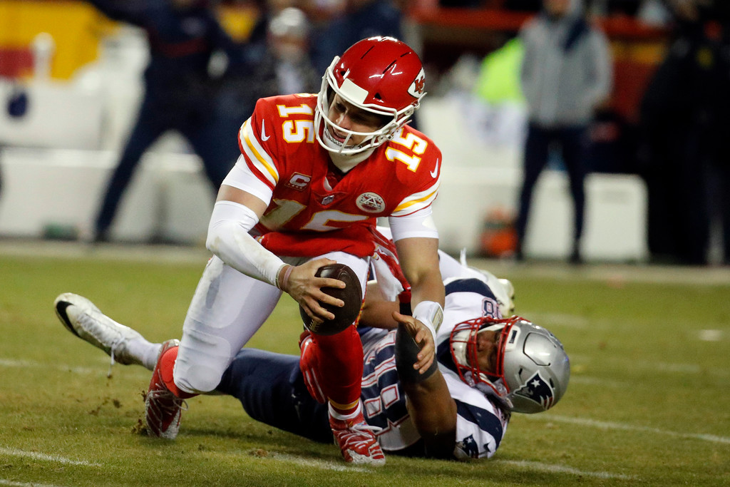 . Kansas City Chiefs quarterback Patrick Mahomes (15) is sacked by New England Patriots defensive end Trey Flowers (98) during the first half of the AFC Championship NFL football game, Sunday, Jan. 20, 2019, in Kansas City, Mo. (AP Photo/Charlie Riedel)