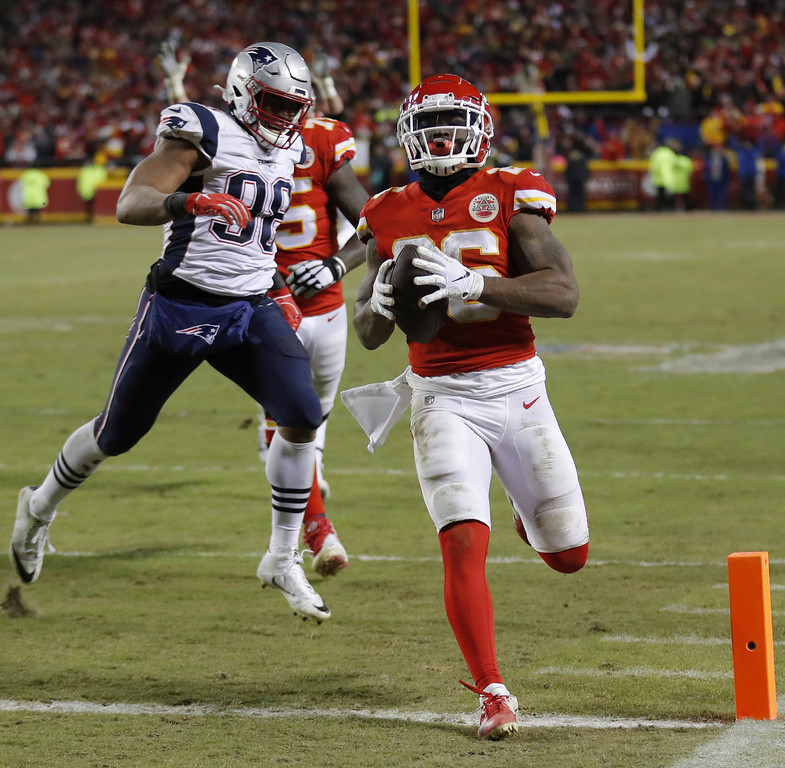 . Kansas City Chiefs running back Damien Williams (26) runs to the end zone for a touchdown during the second half of the AFC Championship NFL football game against the New England Patriots, Sunday, Jan. 20, 2019, in Kansas City, Mo. (AP Photo/Charlie Neibergall)