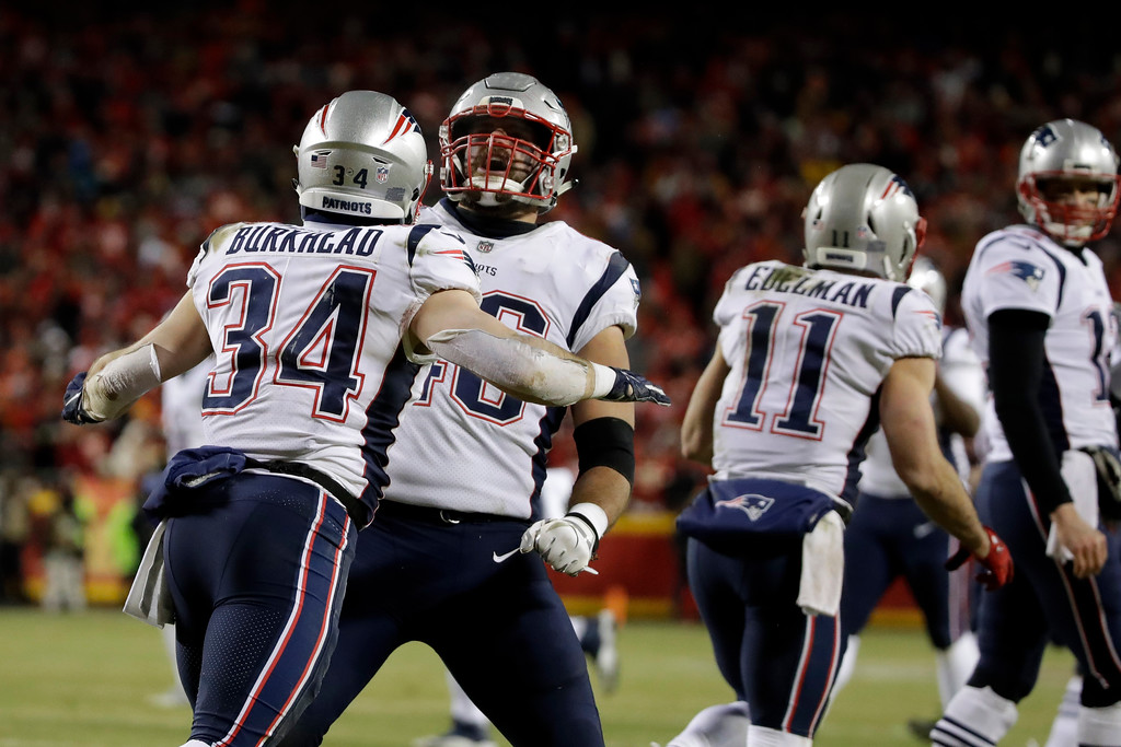 . New England Patriots running back Rex Burkhead (34) celebrates touchdown with fullback James Develin (46) during the second half of the AFC Championship NFL football game against the Kansas City Chiefs, Sunday, Jan. 20, 2019, in Kansas City, Mo. (AP Photo/Elise Amendola)