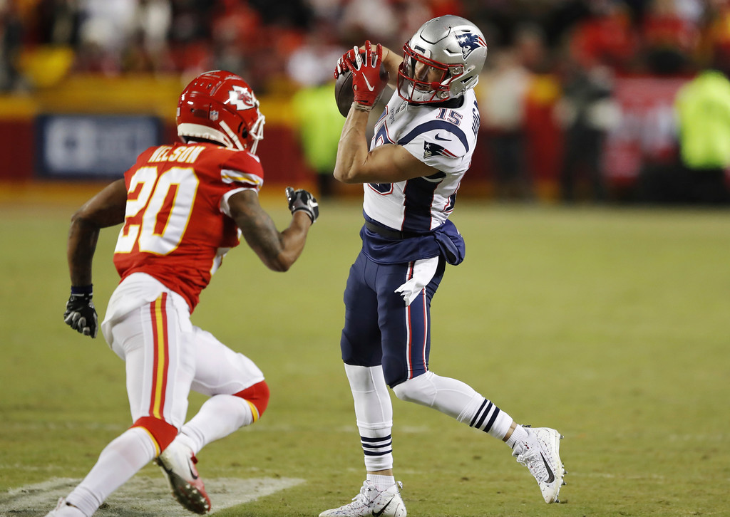. New England Patriots wide receiver Chris Hogan (15) makes a catch against Kansas City Chiefs cornerback Steven Nelson (20) during the second half of the AFC Championship NFL football game, Sunday, Jan. 20, 2019, in Kansas City, Mo. (AP Photo/Charlie Neibergall)