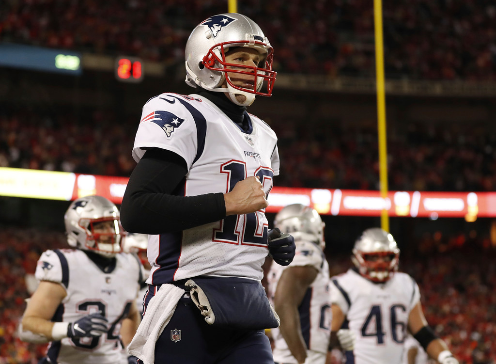 . New England Patriots quarterback Tom Brady (12) celebrates a touchdown during the second half of the AFC Championship NFL football game against the Kansas City Chiefs, Sunday, Jan. 20, 2019, in Kansas City, Mo. (AP Photo/Jeff Roberson)