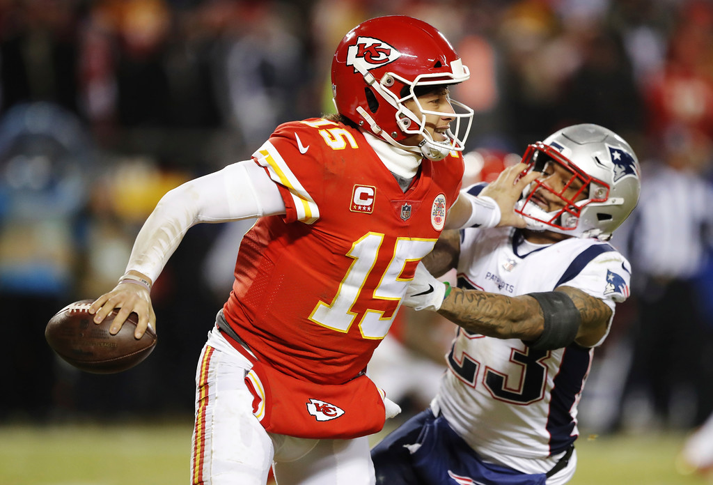 . New England Patriots strong safety Patrick Chung (23) pressures Kansas City Chiefs quarterback Patrick Mahomes during the second half of the AFC Championship NFL football game, Sunday, Jan. 20, 2019, in Kansas City, Mo. (AP Photo/Charlie Neibergall)