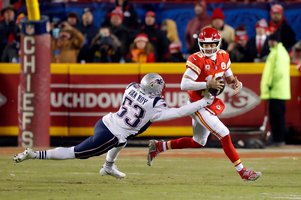 . Kansas City Chiefs quarterback Patrick Mahomes (15) and New England Patriots middle linebacker Kyle Van Noy (53) during the first half of the AFC Championship NFL football game, Sunday, Jan. 20, 2019, in Kansas City, Mo. (AP Photo/Charlie Neibergall)