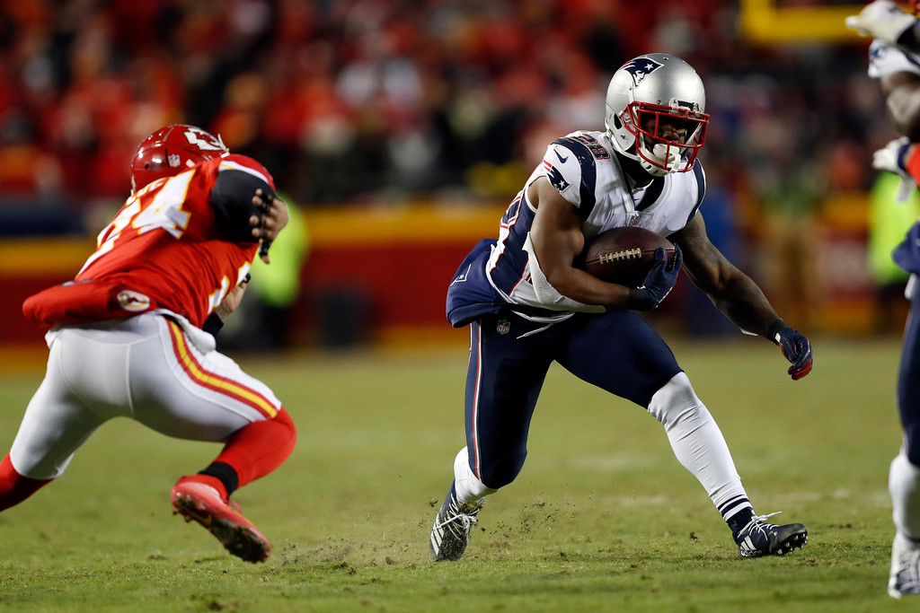 . New England Patriots running back James White (28) runs during the second half of the AFC Championship NFL football game against the Kansas City Chiefs, Sunday, Jan. 20, 2019, in Kansas City, Mo. (AP Photo/Jeff Roberson)