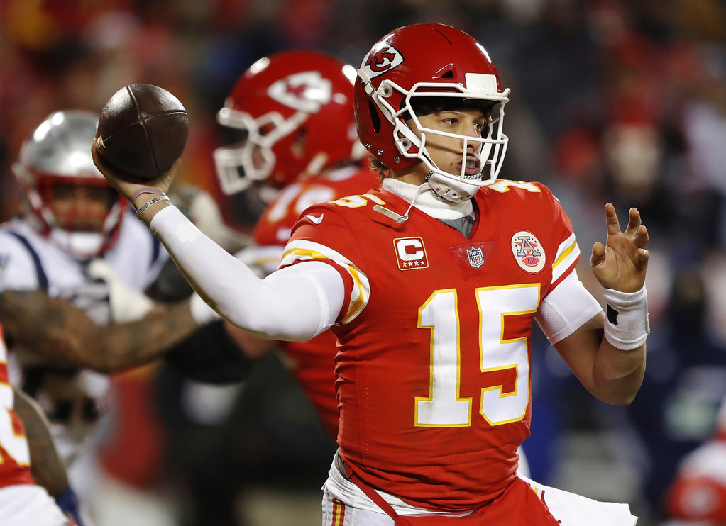 . Kansas City Chiefs quarterback Patrick Mahomes (15) throws a pass during the second half of the AFC Championship NFL football game against the New England Patriots, Sunday, Jan. 20, 2019, in Kansas City, Mo. (AP Photo/Charlie Neibergall)