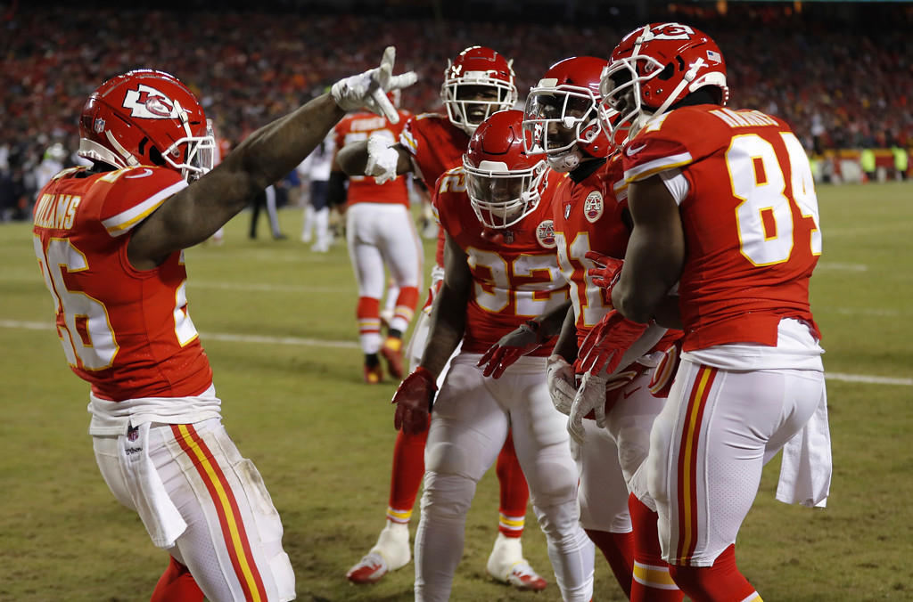. Kansas City Chiefs running back Damien Williams (26) celebrates a touchdown with his teammates during the second half of the AFC Championship NFL football game against the New England Patriots, Sunday, Jan. 20, 2019, in Kansas City, Mo. (AP Photo/Charlie Neibergall)
