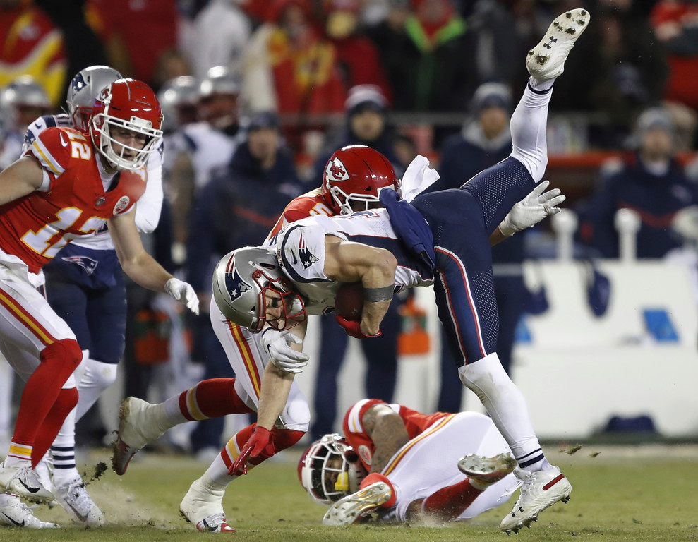 . New England Patriots wide receiver Julian Edelman (11) is tackled by Kansas City Chiefs linebacker Frank Zombo (51) during the second half of the AFC Championship NFL football game, Sunday, Jan. 20, 2019, in Kansas City, Mo. (AP Photo/Charlie Neibergall)