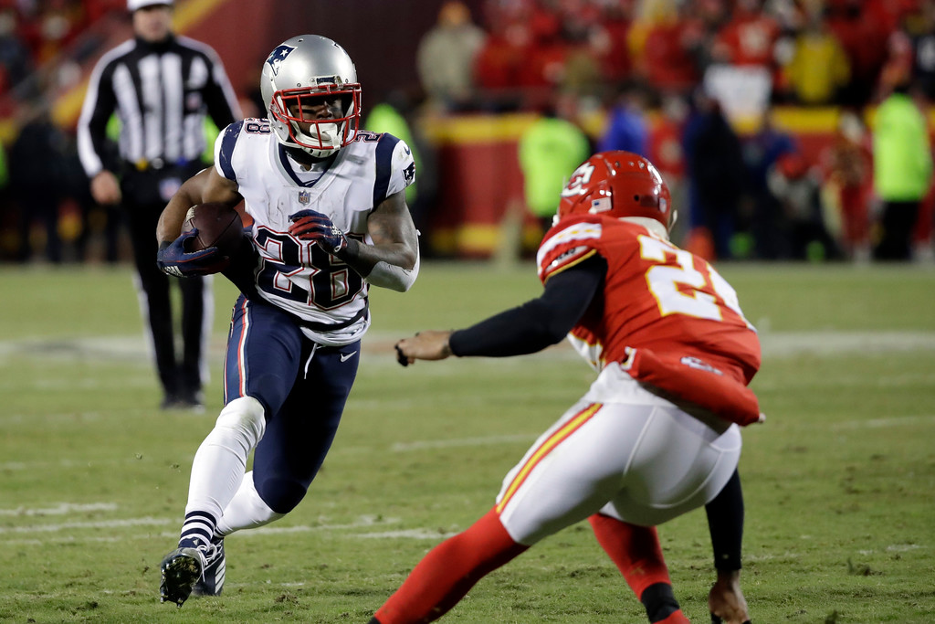 . New England Patriots running back James White (28) runs during the second half of the AFC Championship NFL football game against the Kansas City Chiefs, Sunday, Jan. 20, 2019, in Kansas City, Mo. (AP Photo/Elise Amendola)