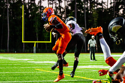 #4 Ted Hurts for Johnson high (orange) catches a pass in the endzone for a touchdown.                              [Hunter D. Cone / Savannah Now]