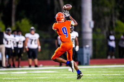 Johnson high's #9 Jermaine Holzendorf completes a pass for a short gain in the first half od the Thursday Night football game at Islands High School Stadium.             [Hunter D. Cone / Savannah Now]