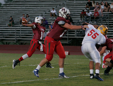 Raul Alvarez (Redwood) throws a pass during the 46th Annual Tulare-Kings All Star Football game on June 22, 2013.