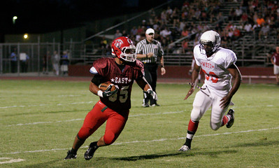 Calvin Snowden TE runs the football after a catch during the 46th Annual East-West Tulare Kings All-Star Football game on June 22, 2013.