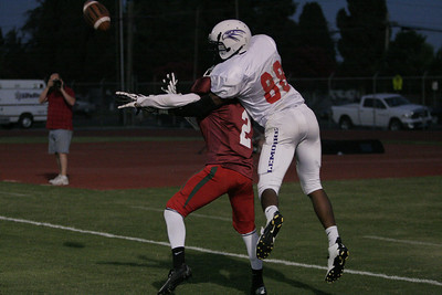 Eddie Cisneros DB (Farmersville) defends against Deshawn Bonner WR (Lemoore) during the 46th Annual Tulare-Kings Football All Star game on June 22, 2013.