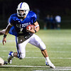 Eddie Rivera carries the ball for Leominster. 	SENTINEL & ENTERPRISE / GARY FOURNIER