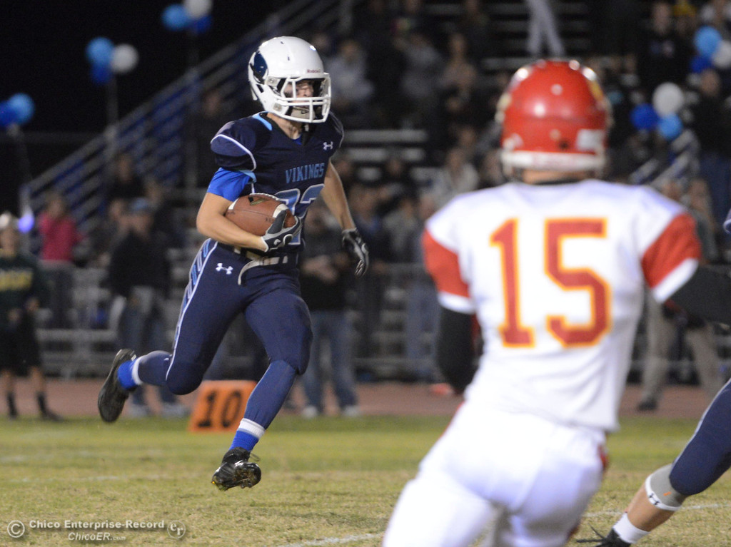 . Pleasant Valley High\'s #22 Jake Dani (left) returns a kickoff against Chico High in the first quarter of their Almond Bowl football game at CSUC University Stadium Friday, November 1, 2013 in Chico, Calif.  (Jason Halley/Chico Enterprise-Record)