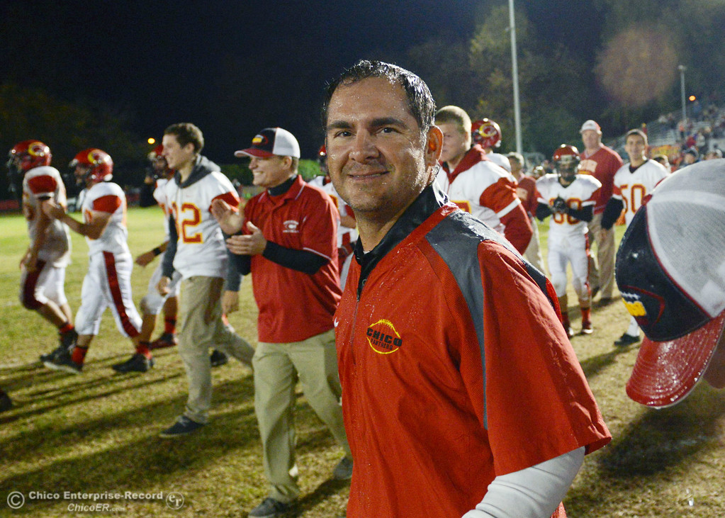 . Chico High coach Jason Alvistur is drenched in water against Pleasant Valley High in the fourth quarter of their Almond Bowl football game at CSUC University Stadium Friday, November 1, 2013 in Chico, Calif.  (Jason Halley/Chico Enterprise-Record)