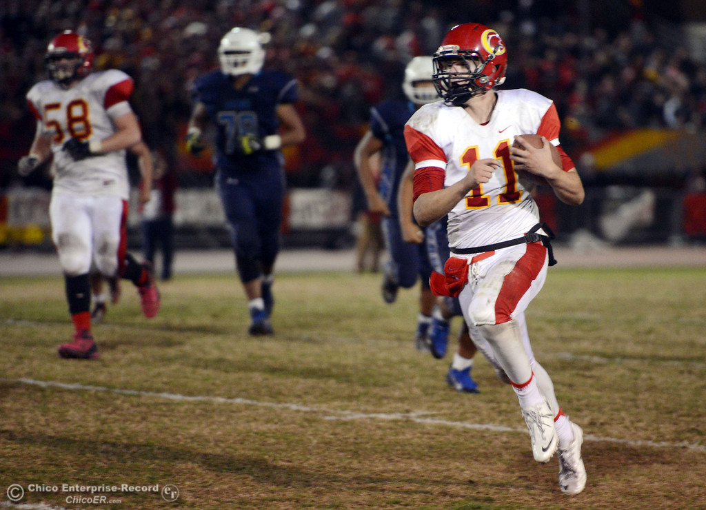 . Chico High\'s #11 Clayton Welch runs the ball for a first down against Pleasant Valley High in the second quarter of their Almond Bowl football game at CSUC University Stadium Friday, November 1, 2013 in Chico, Calif.  (Jason Halley/Chico Enterprise-Record)