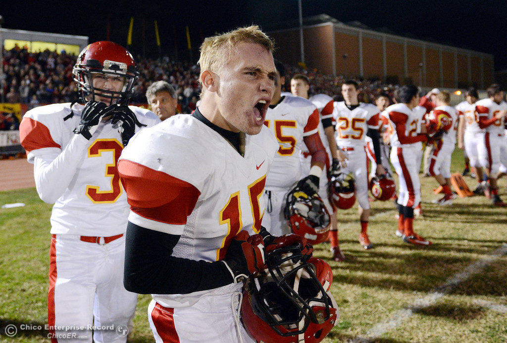 . Chico High\'s #15 Miles Fishback gets excited against Pleasant Valley High in the first quarter of their Almond Bowl football game at CSUC University Stadium Friday, November 1, 2013 in Chico, Calif.  (Jason Halley/Chico Enterprise-Record)