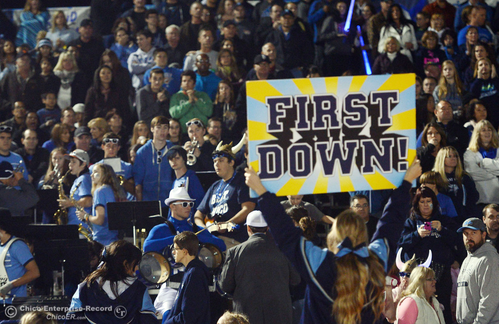 . Pleasant Valley High cheerleader puts up a sign against Chico High in the second quarter of their Almond Bowl football game at CSUC University Stadium Friday, November 1, 2013 in Chico, Calif.  (Jason Halley/Chico Enterprise-Record)