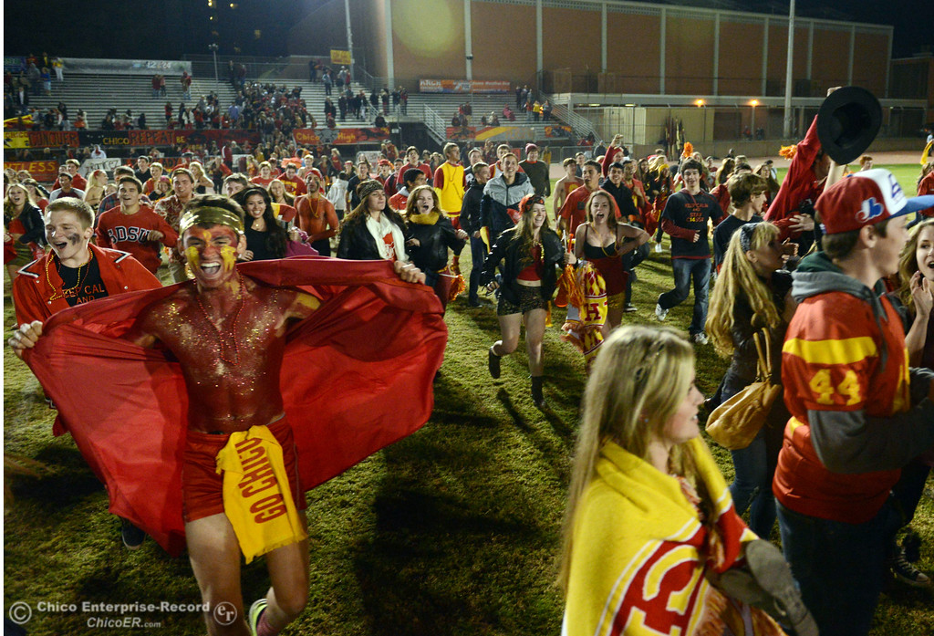 . Chico High fans celebrate their win against  Pleasant Valley High at the end of the fourth quarter of their Almond Bowl football game at CSUC University Stadium Friday, November 1, 2013 in Chico, Calif.  (Jason Halley/Chico Enterprise-Record)
