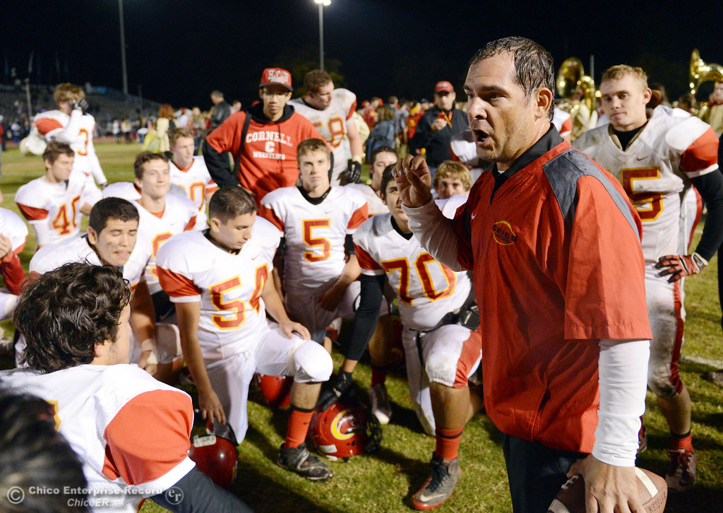 . Chico High coach Jason Alvistur talks to the team against Pleasant Valley High at the end of the fourth quarter of their Almond Bowl football game at CSUC University Stadium Friday, November 1, 2013 in Chico, Calif.  (Jason Halley/Chico Enterprise-Record)