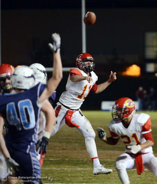 . Chico High\'s #11 Clayton Welch throws a touchdown pass to #27 Noah Collado (not seen) against Pleasant Valley High in the second quarter of their Almond Bowl football game at CSUC University Stadium Friday, November 1, 2013 in Chico, Calif.  (Jason Halley/Chico Enterprise-Record)