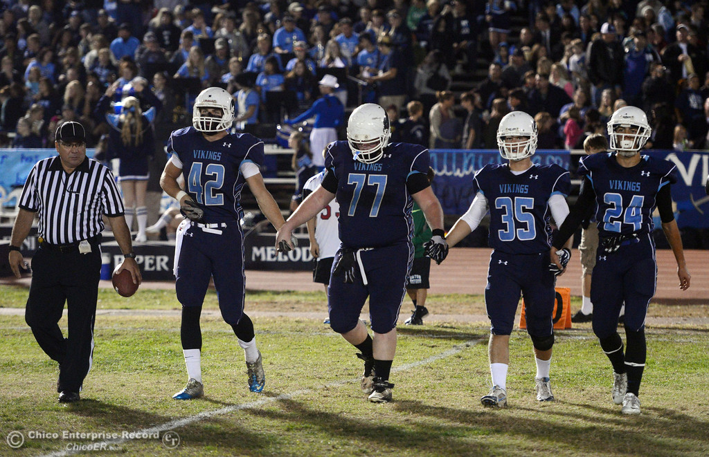. Pleasant Valley High\'s #42 Chad Olsen, #77 Tyler Stimac, #35 Benjamin Whitmore, and #24 Jack Soza (left to right) come out for the coin toss against Chico High in the first quarter of their Almond Bowl football game at CSUC University Stadium Friday, November 1, 2013 in Chico, Calif.  (Jason Halley/Chico Enterprise-Record)
