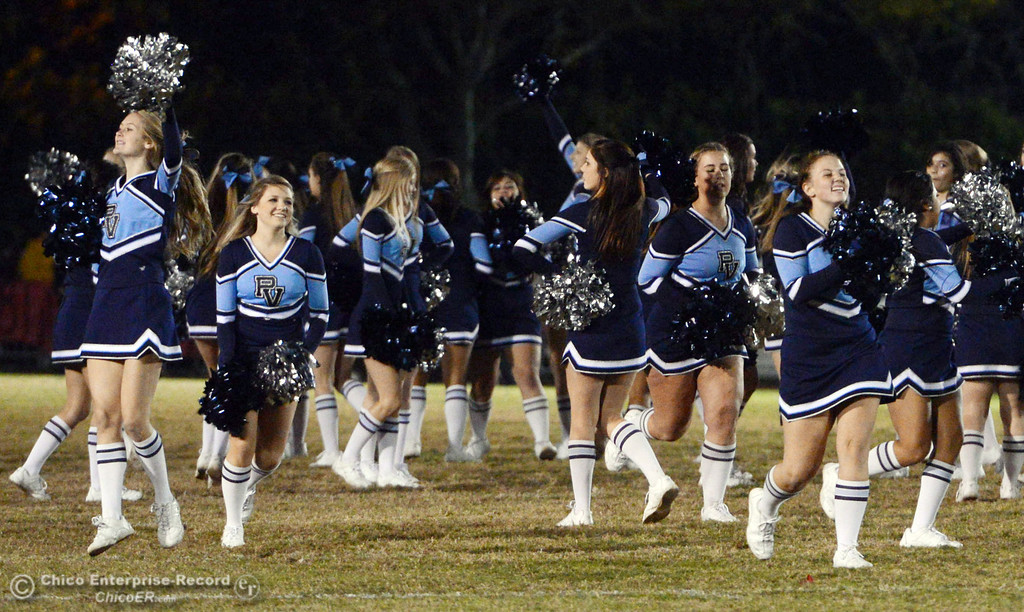 . Pleasant Valley High cheerleaders perform during halftime of their Almond Bowl football game against Chico High at CSUC University Stadium Friday, November 1, 2013 in Chico, Calif.  (Jason Halley/Chico Enterprise-Record)