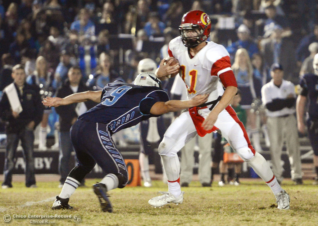 . Chico High\'s #11 Clayton Welch (right) is tackeld against Pleasant Valley High\'s #9 Houston McGowan (left) in the first quarter of their Almond Bowl football game at CSUC University Stadium Friday, November 1, 2013 in Chico, Calif.  (Jason Halley/Chico Enterprise-Record)