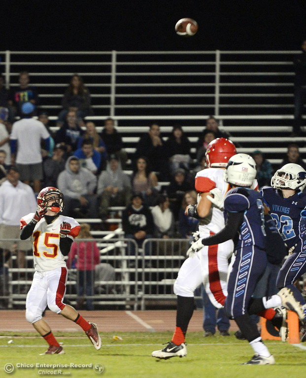 . Chico High\'s #15 Miles Fishback makes a catch against Pleasant Valley High in the first quarter of their Almond Bowl football game at CSUC University Stadium Friday, November 1, 2013 in Chico, Calif.  (Jason Halley/Chico Enterprise-Record)