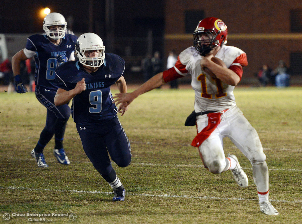 . Chico High\'s #11 Clayton Welch (right) runs for a touchdown against Pleasant Valley High\'s #9 Houston McGowan (left) in the third quarter of their Almond Bowl football game at CSUC University Stadium Friday, November 1, 2013 in Chico, Calif.  (Jason Halley/Chico Enterprise-Record)