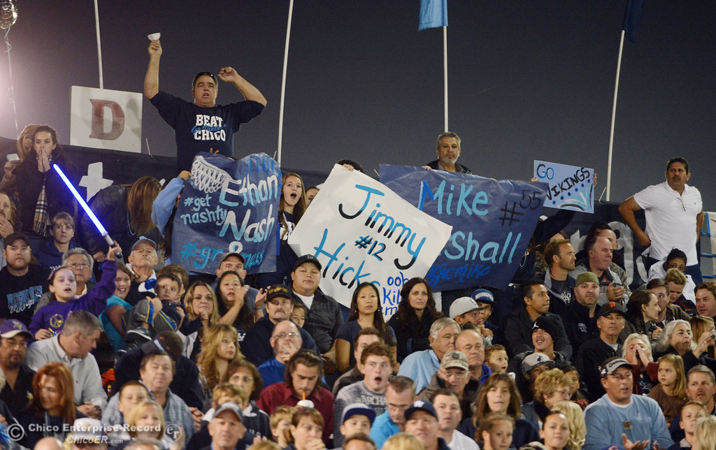 . Pleasant Valley High fans cheer on against Chico High in the first quarter of their Almond Bowl football game at CSUC University Stadium Friday, November 1, 2013 in Chico, Calif.  (Jason Halley/Chico Enterprise-Record)