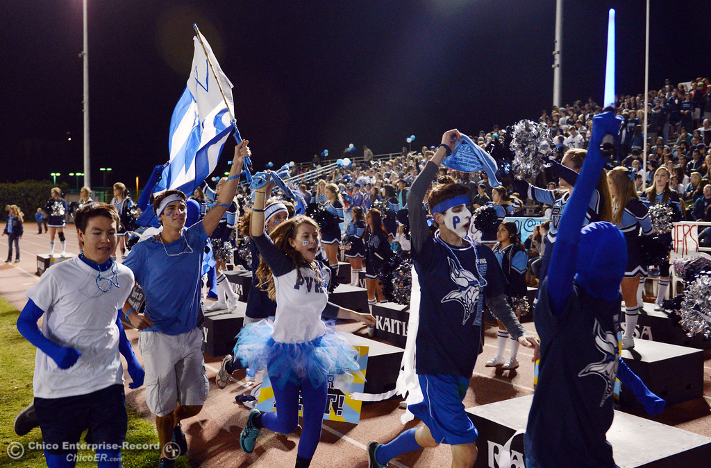 . Pleasant Valley High fans run down the track to cheer on against Chico High in the second quarter of their Almond Bowl football game at CSUC University Stadium Friday, November 1, 2013 in Chico, Calif.  (Jason Halley/Chico Enterprise-Record)