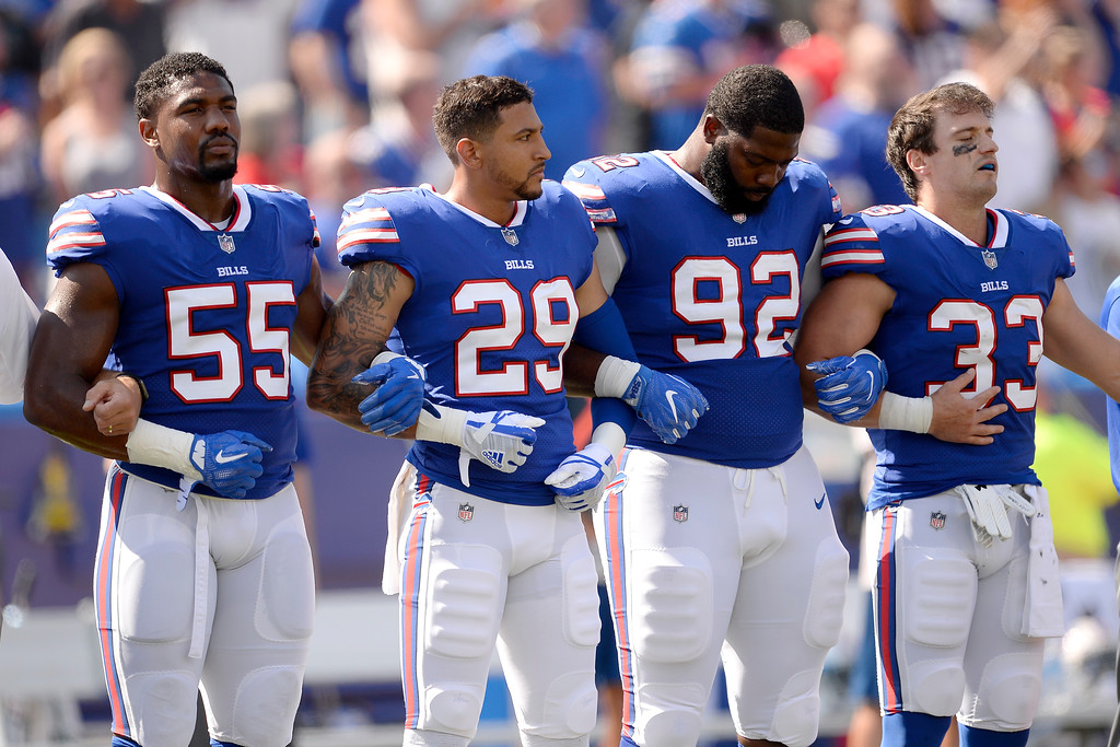. Buffalo Bills players listen to the national anthem prior to an NFL football game against the Denver Broncos, Sunday, Sept. 24, 2017, in Orchard Park, N.Y. (AP Photo/Adrian Kraus)