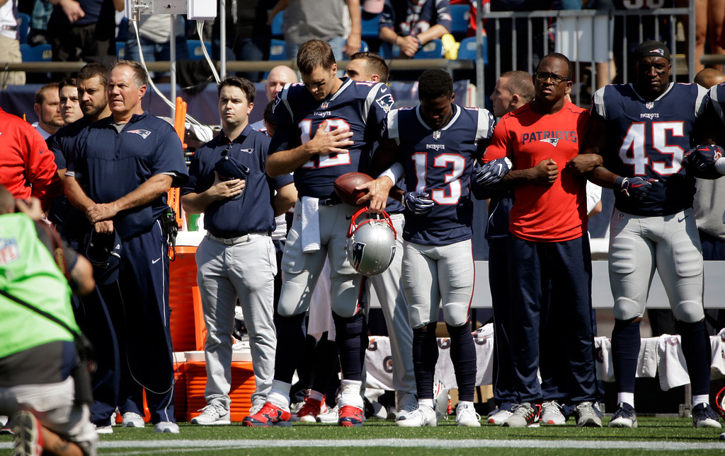 . New England Patriots head coach Bill Belichick, left, and Tom Brady (12) Phillip Dorsett (13) Matthew Slater, second from right, and David Harris (45) stand during the national anthem before an NFL football game against the Houston Texans, Sunday, Sept. 24, 2017, in Foxborough, Mass. (AP Photo/Steven Senne)