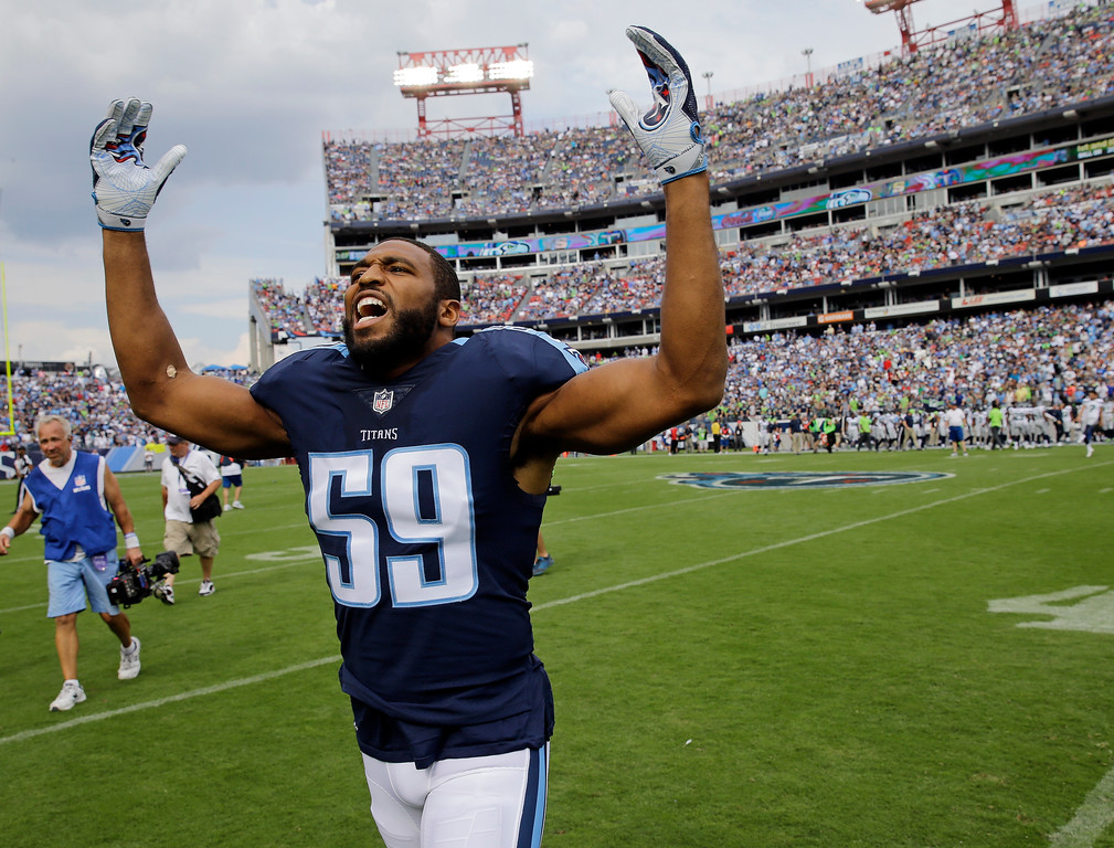 . Tennessee Titans inside linebacker Wesley Woodyard yells to the crowd after the players came onto the field after the national anthem had been played before an NFL football game between the Titans and the Seattle Seahawks Sunday, Sept. 24, 2017, in Nashville, Tenn. (AP Photo/James Kenney)