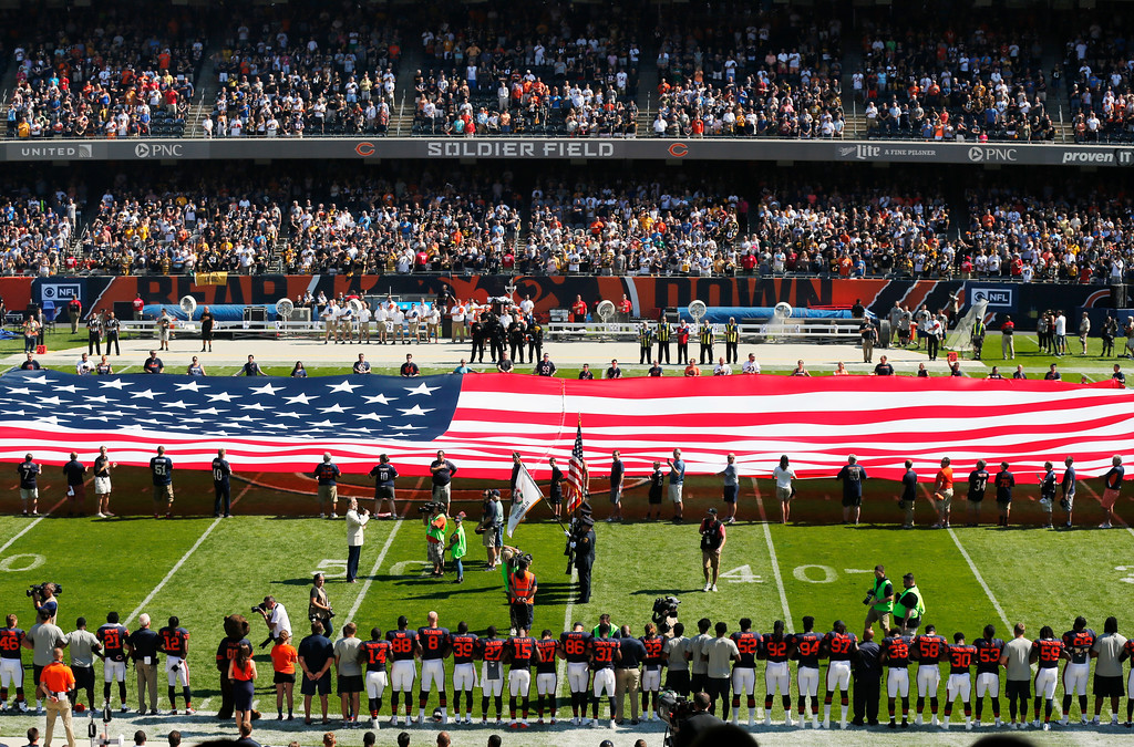 . The Pittsburgh Steelers side of the field is nearly empty during the playing of the national anthem before an NFL football game between the Steelers and Chicago Bears, Sunday, Sept. 24, 2017, in Chicago. (AP Photo/Kiichiro Sato)