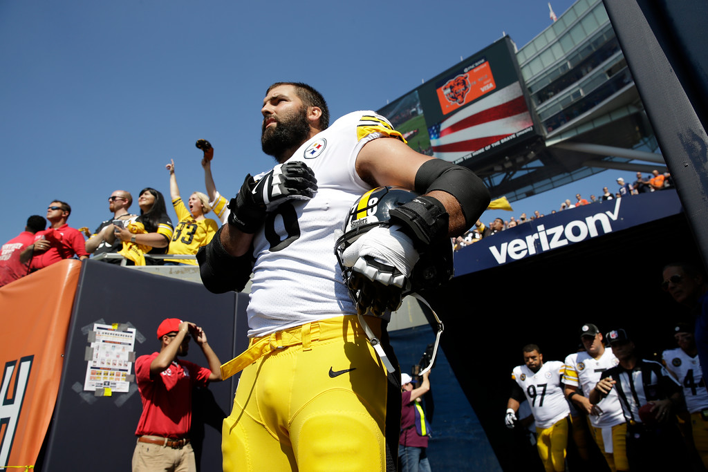 . Pittsburgh Steelers offensive tackle and former Army Ranger Alejandro Villanueva (78) stands outside the tunnel alone during the national anthem before an NFL football game against the Chicago Bears, Sunday, Sept. 24, 2017, in Chicago. (AP Photo/Nam Y. Huh)