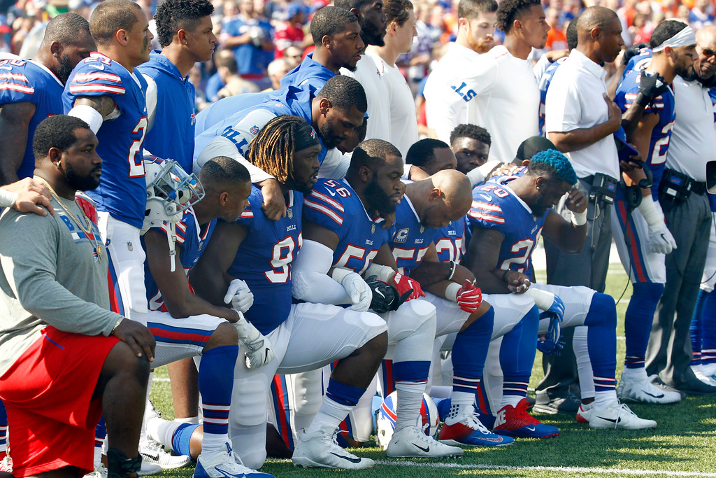 . Buffalo Bills players take a knee during the playing of the national anthem prior to an NFL football game against the Denver Broncos, Sunday, Sept. 24, 2017, in Orchard Park, N.Y. (AP Photo/Jeffrey T. Barnes)