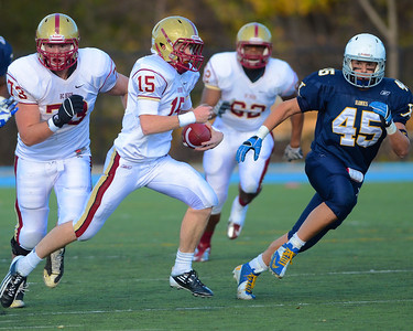 110312, Westwood, MA - Boston College High School's Dan Collins (15) rushes downfield with Xaverian's Kenny Kern (45) during Saturday's game as BC's Jack McDonald (73) and Harry Verenis (62) give chase. Herald photo by Ryan Hutton