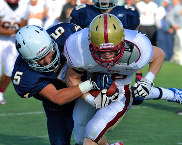 110312, Westwood, MA - Boston College High School's Mark McGuire (88) is taken down on a run by Xaverian's Joe DeNucci Jr. (5) during Saturday's game. Herald photo by Ryan Hutton