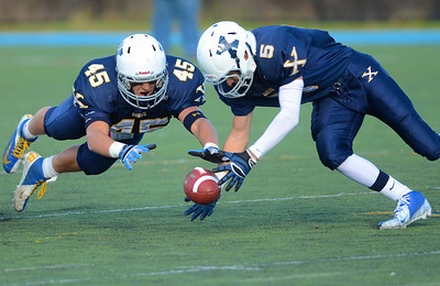 110312, Westwood, MA - Xaverian's Kenny Kern (45) and Joe DeNucci Jr. go to recover a fumble from Boston College High School's Dan Collins during Saturday's game. Herald photo by Ryan Hutton